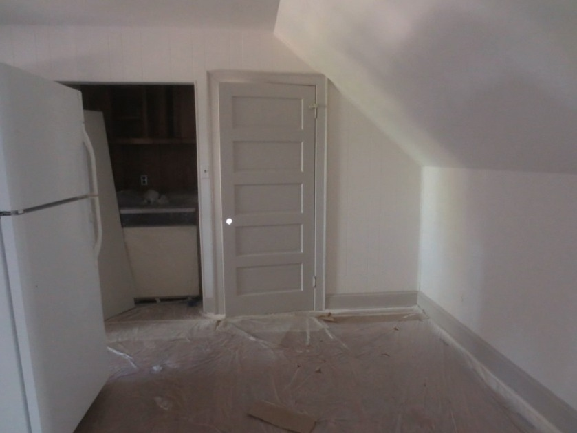 The kitchen alcove on the left will brighten with the kitchen installation.