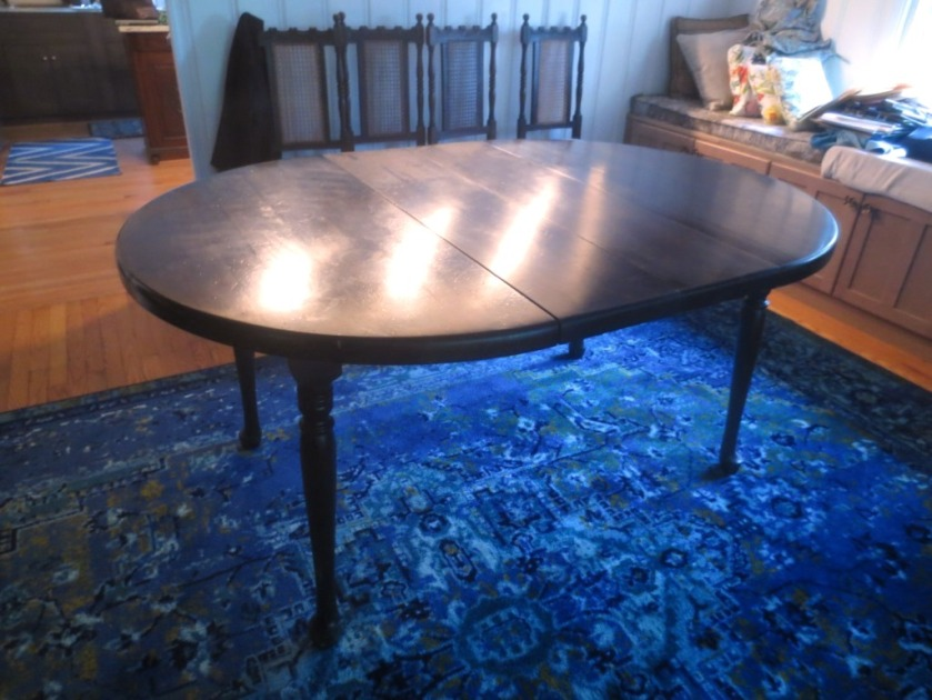 The dining room table is a round that becomes oval when two leaves are inserted.