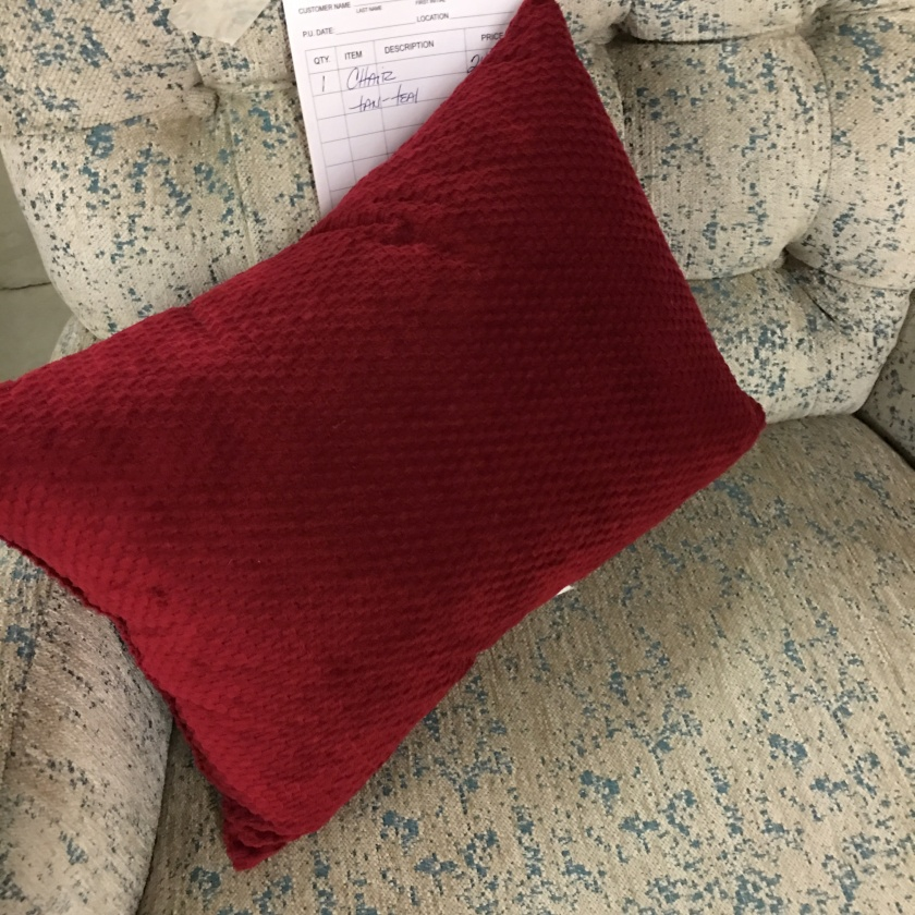 Cranberry velvet pillow will work on the sofa or bed.