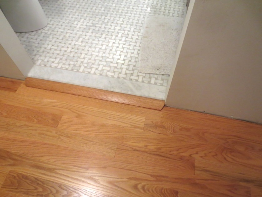 The floor in the master hallway has a reducer at the bathroom doorway.