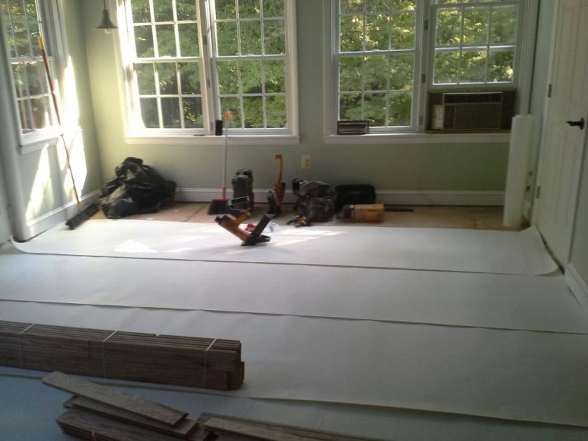 Paper is laid under the oak boards.