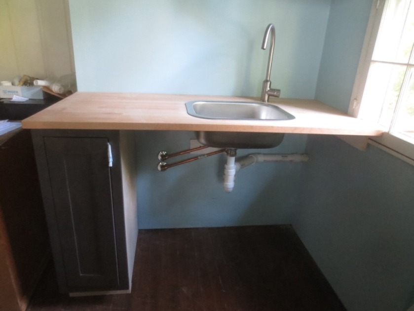One cabinet supports the countertop. another one could enclose the sink.