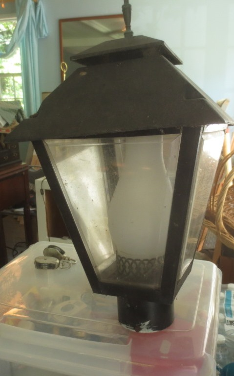 When we removed the front path this light went, too. Sold for $5.