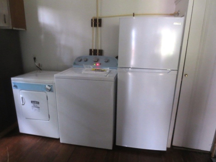 Left to right: Dryer, washer, refrigerator, water heater closet.