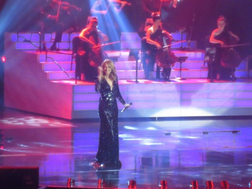 The orchestra would do funny things behind Celine like get-up-and-sit-down or wave their instruments.