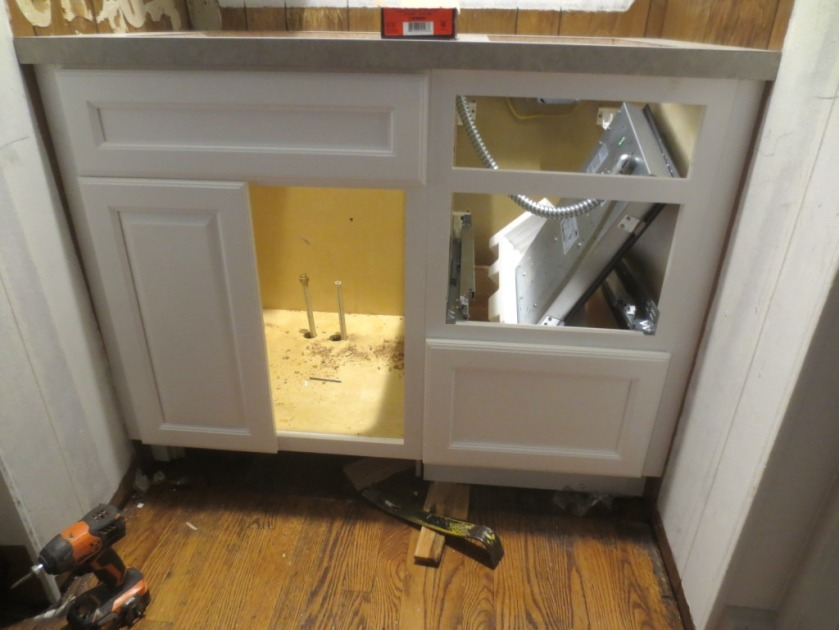 The base cabinet was plumbed and electrified.