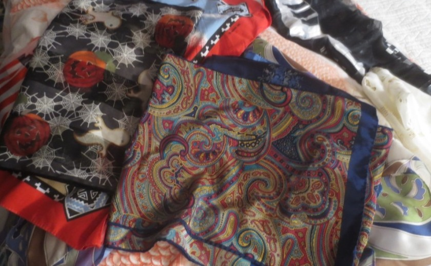 A pile of scarves I feel comfortable donating.