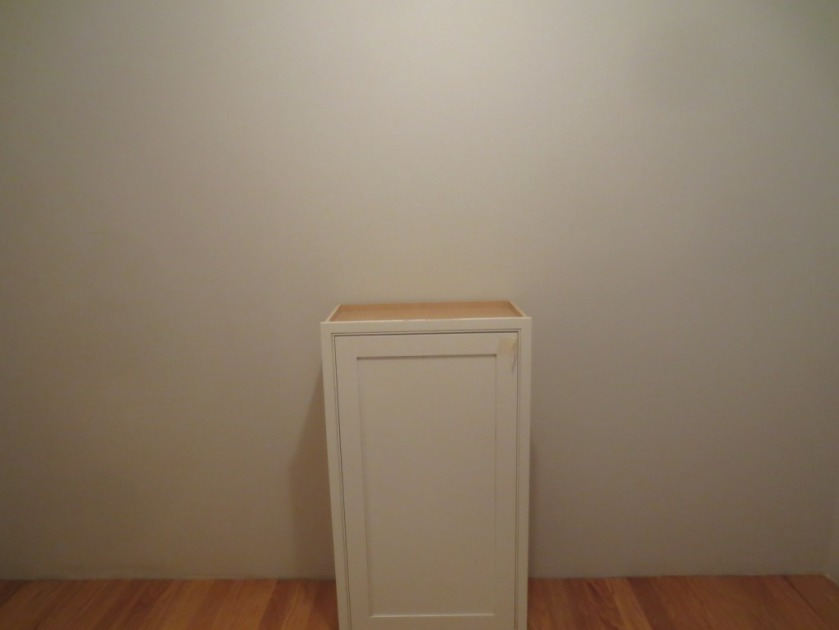 I plan to set my cabinet in the center of my wall above some drawers.