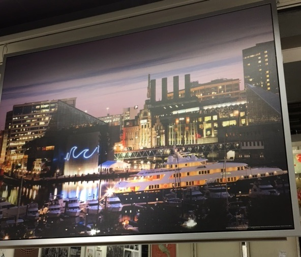 55 inches wide by 39-1/2inches tall a color photo of Baltimore, Maryland, at night.