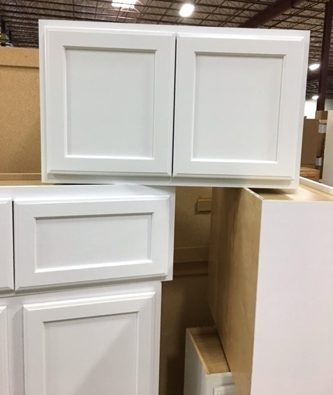 "The top cabinet is 30"" wide by 18"" tall."