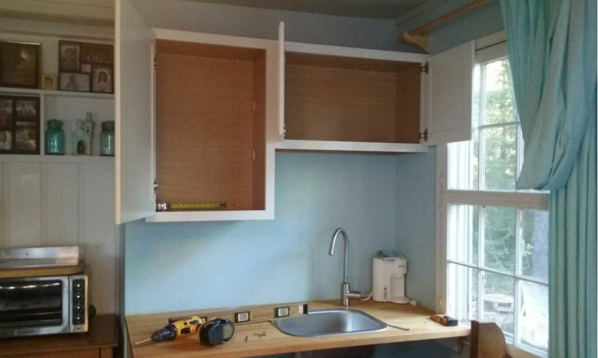 The Cottage carpenter hung the cabinets above the counter and sink.