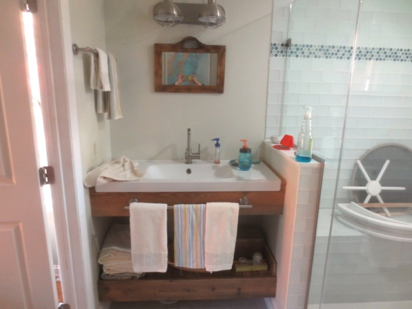 Towel bars have been hung near the sink.