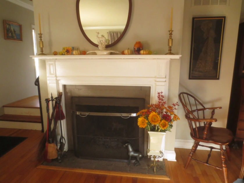 "The dark area inside the mantelpiece is brick painted Benjamin Moore's ""Swallow""."