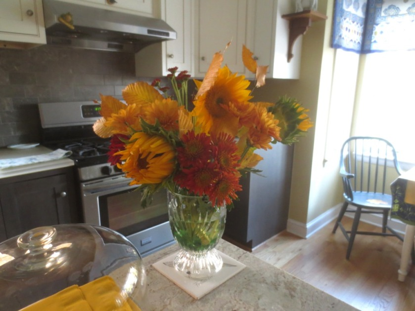 The kitchen island was brightened up with flowers.