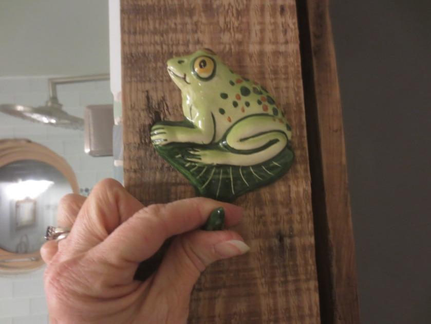 A ceramic frog hook.