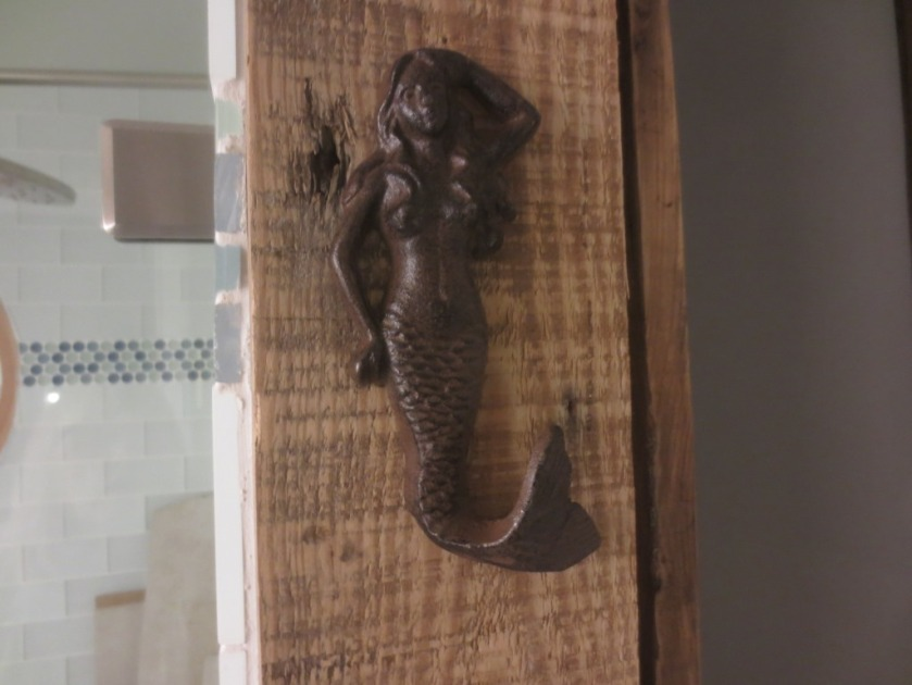 The mermaid hook is the right style of rustic.