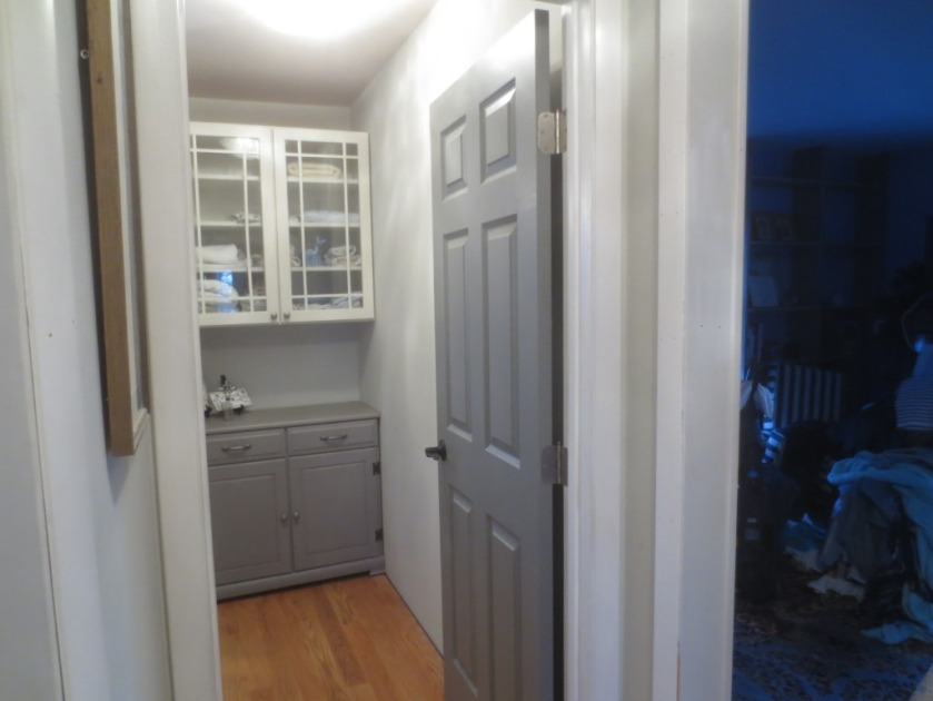 The door color is similar to the color on the bottom of the linen closet which I custom mixed but a little cooler.