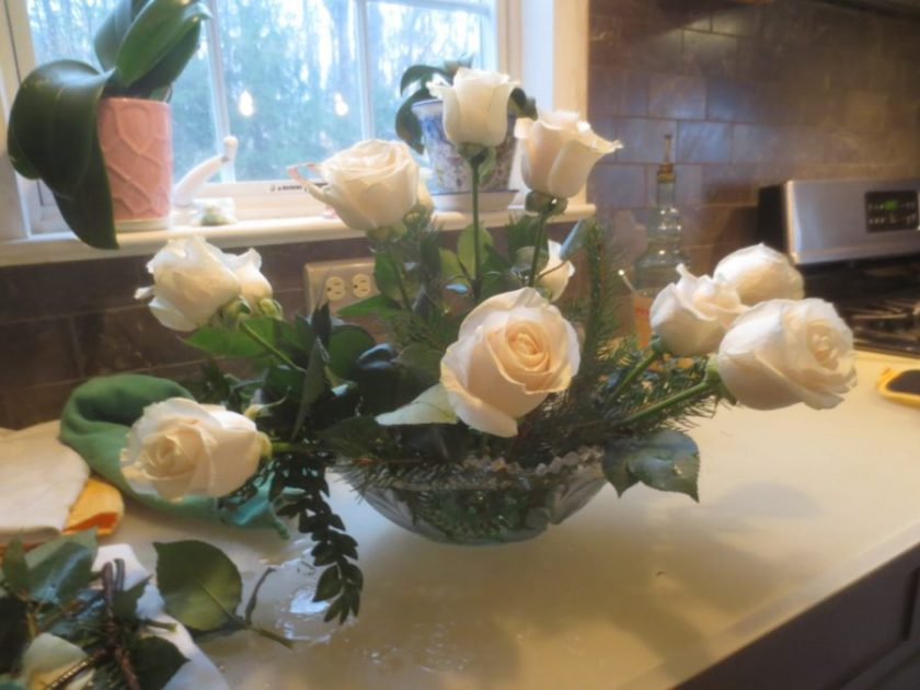 Loving bouquets of white roses all over the house.