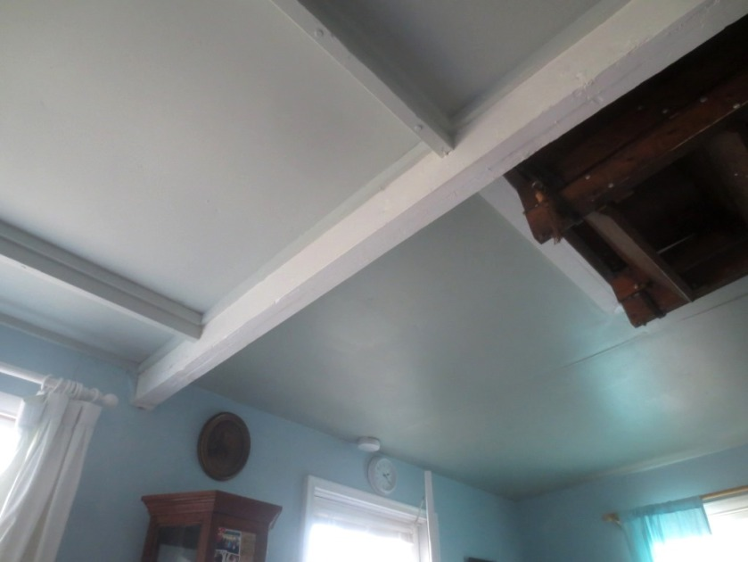 On the left the old paint; on the right the newly painted ceiling.
