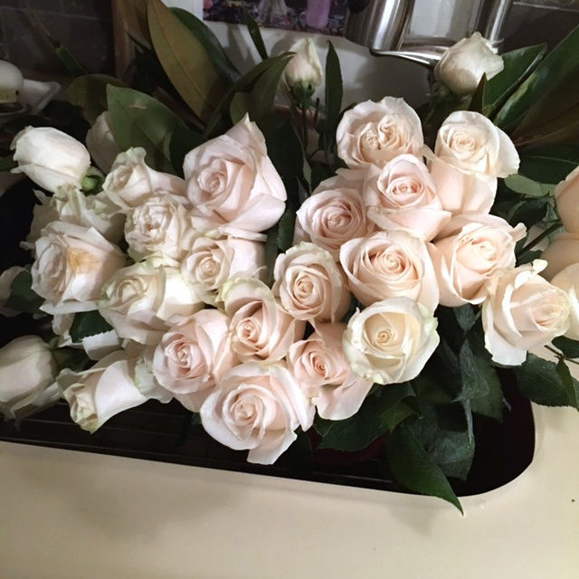 White roses with a pale pink tint.