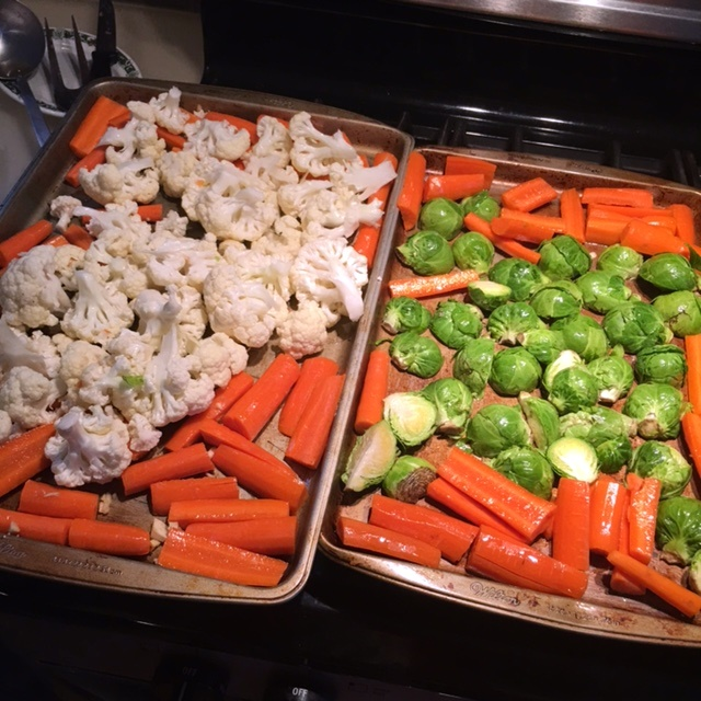 Oiled vegetables ready for roasting.