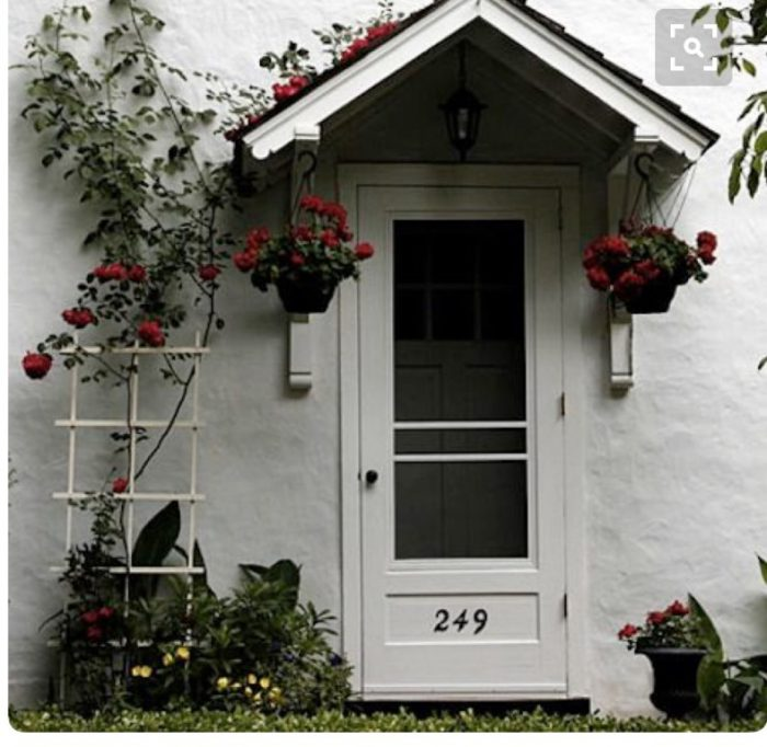This is a sweet cottage-style entrance.