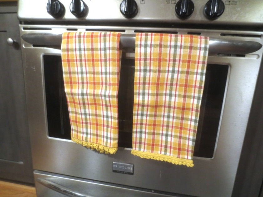 A friend at work embellished the edge of these kitchen towels with a bit of crochet -- I love a handmade gift.