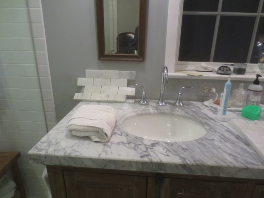 Now I have to decide whether to use the marble or the white from the shower wall.