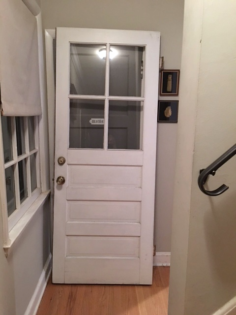 This solid wood door with 4 lights might fit the opening in the laundry room perfectly.