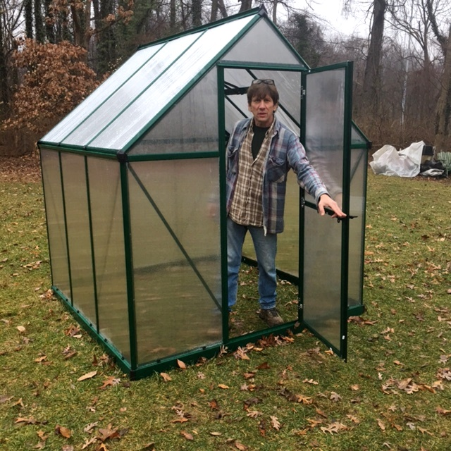 Charlie looks forward to using his greenhouse.