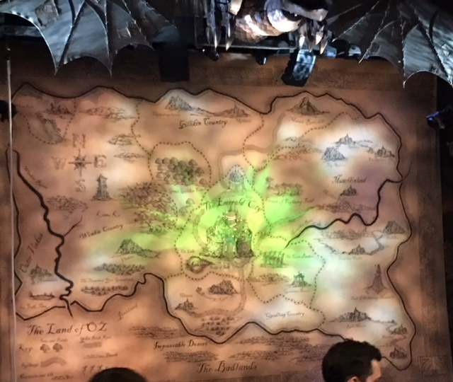 The grand drape for Wicked is a map of Oz and surrounding territories.