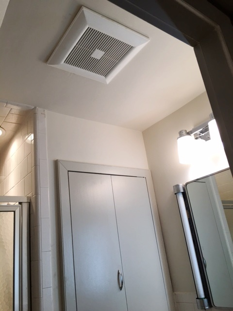 Effectiveness of exhaust fans are easy to check with a sheet of paper. If it isn't sucked toward the fan the fan doesn't draw.