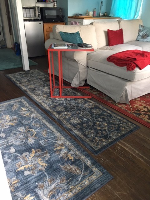 The aqua rug has been relegated to the back of The Cottage near the bathroom/laundry area.