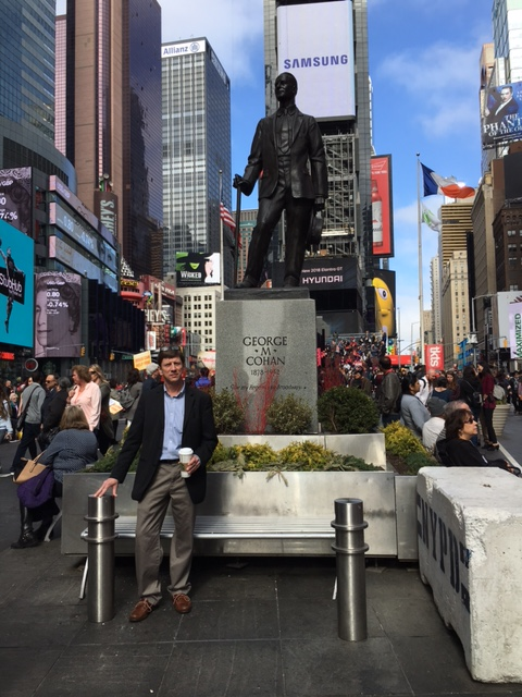 Charlie posed with the statue of George M. Cohan in Times Square, aka Father Duffy Square.